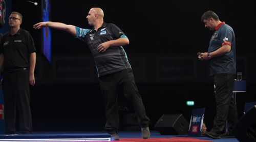 Rob Cross besiegte Mensur Suljovic